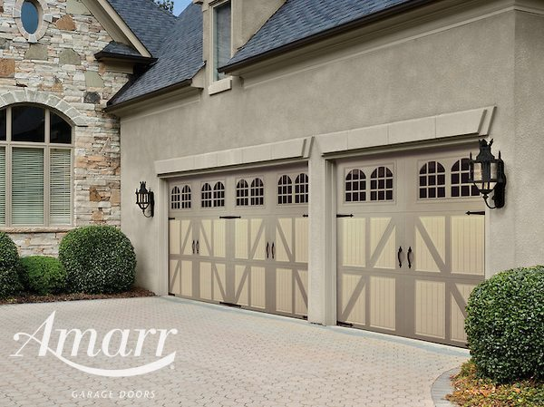 Amarr - Twin Santiago style darker tan garage doors on a Residential home